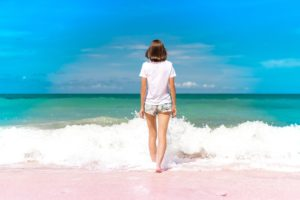 woman in shorts on beach